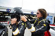 Bruce Jenner helps Brandon Jenner put his helmet on before thursday testing.