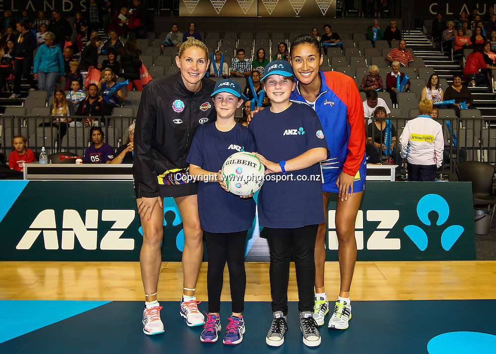 ANZ Future Captains Taylor Young aged 10 (L) and Simone Peers aged 12 (R) pose with Waikato BOP Magic captain Casey Kopua and Northern Mystic captain Maria Tutaia ahead of the  ANZ Championship netball match - Waikato BOP Magic v Northern Mystics at Claudelands Arena, Hamilton, New Zealand on Saturday 20 April 2014.  Photo:  Bruce Lim / www.photosport.co.nz