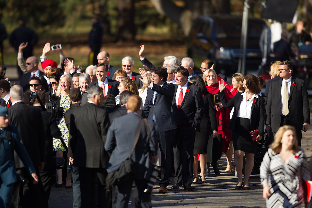 Prime Minister designate Justin Trudeau leads his cabinet appointees up the drive at Rideau Hall as the new Canadian government prepares to be sworn in in Ottawa, Ontario, November 4, 2015.<br /> AFP PHOTO/ GEOFF ROBINS