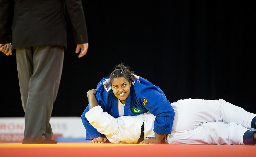 Maria Suelen Altheman of Brazil smiles after defeating Leidi German of the Dominican Republic to win the bronze medal in the women's judo +78kg class at the 2015 Pan American Games in Toronto, Canada, July 14,  2015.  AFP PHOTO/GEOFF ROBINS