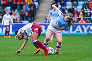 Manchester City Women midfielder Tyler Toland (12) tackles West Ham United Women forward Jacynta Galabadaarachchi (15) during the FA Women's Super League match between Manchester City Women and West Ham United Women at the Sport City Academy Stadium, Manchester, United Kingdom on 17 November 2019.