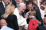 Rome oct 7th 2015, weekly general audience in St Peter's Square. In the picture pope Francis with a family
