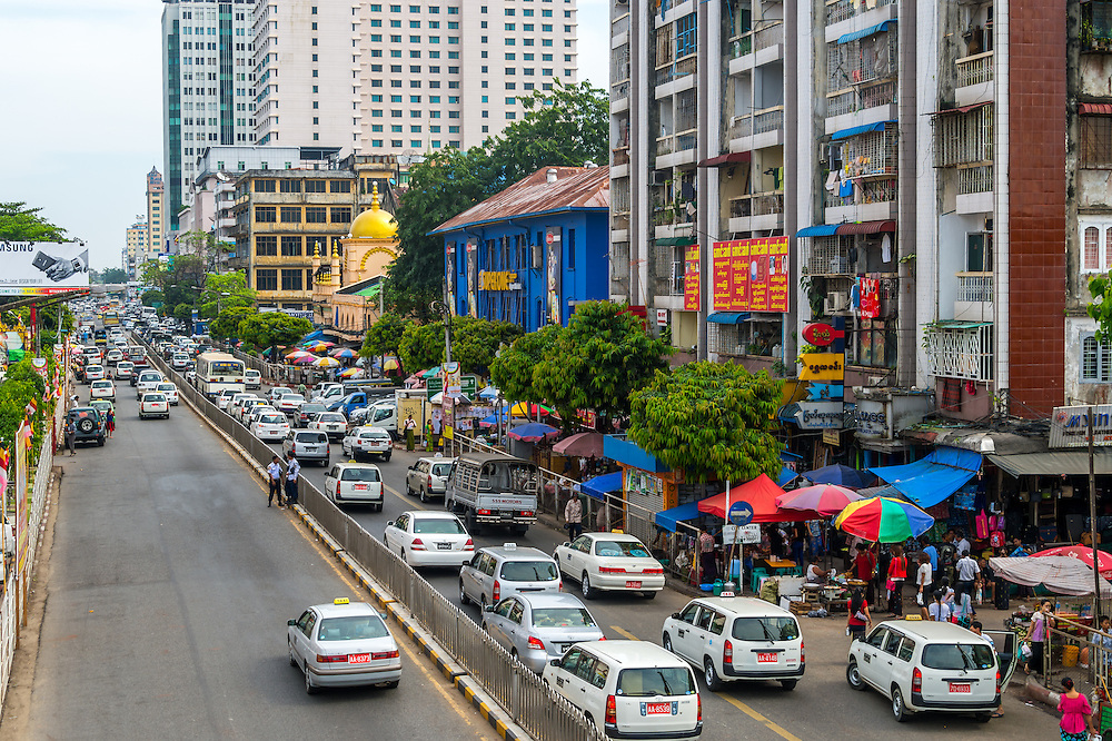 YANGON, MYANMAR - CIRCA DECEMBER 2013: View of the street Bo Gyoke Aung San Rd in Downtown Yangon