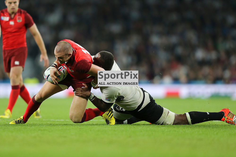 TWICKENHAM, ENGLAND - SEPTEMBER 18:  England's Fullback Mike Brown (15) is brought down during the opening game of the Rugby World Cup between England and Fiji at Twickenham on September 18, 2015 in London, England. (Credit: SAM TODD | SportPix.org.uk)
