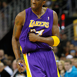 February 5, 2011; New Orleans, LA, USA; Los Angeles Lakers shooting guard Kobe Bryant (24) reacts after hitting a shot against the New Orleans Hornets during the third quarter at the New Orleans Arena. The Lakers defeated the Hornets 101-95.  Mandatory Credit: Derick E. Hingle