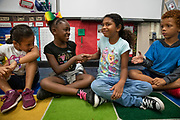 Students in Lindsey Billings 2nd grade classroom shake hands with their neighbor during their community circle, one of the school's SEL Kernel lessons focusing on citizen power at Hagginwood Elementary School in Sacramento, CA on Thursday September 5, 2019.