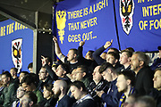 AFC Wimbledon fans shouting during the EFL Sky Bet League 1 match between AFC Wimbledon and Milton Keynes Dons at the Cherry Red Records Stadium, Kingston, England on 22 September 2017. Photo by Matthew Redman.