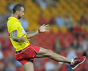 """Quade Cooper assisting with the Reds warmup prior to the Super 15 Rugby Union match (Round 7) between the Queensland Reds and the ACT Brumbies played at Suncorp Stadium (Brisbane, Australia) on Good Friday 6th April 2012 ~ Queensland (20) defeated the Brumbies (13) ~ This image is intended for Editorial use only - Required Images Credit """"Steven Hight - Aura Images"""""""
