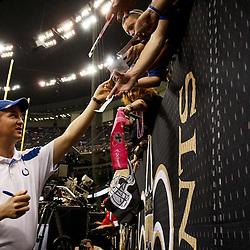 October 23, 2011; New Orleans, LA, USA; Indianapolis Colts quarterback Peyton Manning (18) signs autographs prior to kickoff of a game against the New Orleans Saints at the Mercedes-Benz Superdome. Mandatory Credit: Derick E. Hingle-US PRESSWIRE / © Derick E. Hingle 2011