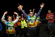 "People wave the arms as they  run on the 20th Korrika. Castejon. (Basque Country). March 31, 2017. The ""Korrika"" is a relay course, with a wooden baton that passes from hand to hand without interruption, organised every two years in a bid to promote the basque language. The Korrika runs over 11 days and 10 nights, crossing many Basque villages and cities. This year was the 20th edition and run more than 2500 Kilometres. Some people consider it an honour to carry the baton with the symbol of the Basques, ""buying"" kilometres to support Basque language teaching. (Gari Garaialde / Bostok Photo)"
