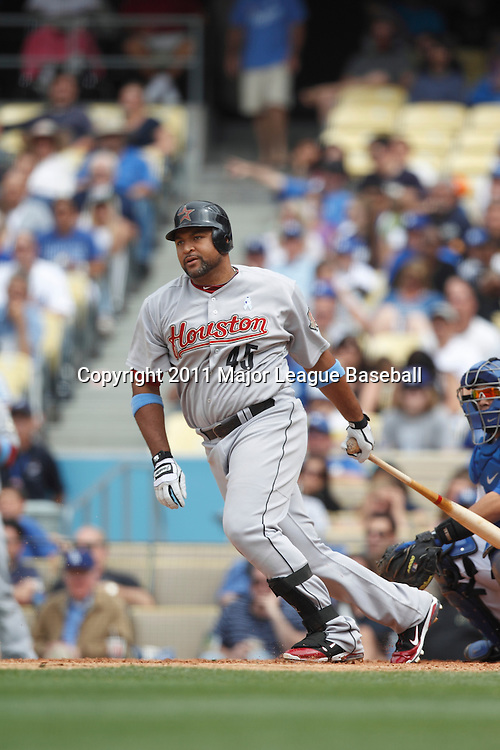 LOS ANGELES - JUNE 19:  Carlos Lee #45 of the Houston Astros watches the ball after making contact with a pitch during the game against the Los Angeles Dodgers at Dodger Stadium on Sunday, June 19, 2011 in Los Angeles, California.  The Dodgers defeated the Astros 1-0.  (Photo by Paul Spinelli/MLB Photos via Getty Images) *** Local Caption *** Carlos Lee