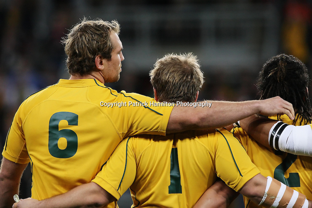 Wallabie captain Rocky Elsom (l) embraces Benn Robinson & Saia Faingaa (r) during the Australian national anthem before the Tri-Nations rugby Test at Suncorp Stadium in Brisbane,  July 24, 2010. The Wallabies defeated the world champion Springboks to win the first Tri-nations rugby Test 30-13. Photo: Patrick Hamilton/Photosport