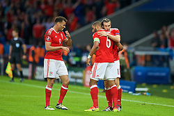 5LILLE, FRANCE - Friday, July 1, 2016: Wales' Hal Robson-Kanu laughs as Gareth Bale hugs captain Ashley Williams as they celebrate the equalising goal during the UEFA Euro 2016 Championship Quarter-Final match against Belgium at the Stade Pierre Mauroy. (Pic by Paul Greenwood/Propaganda)