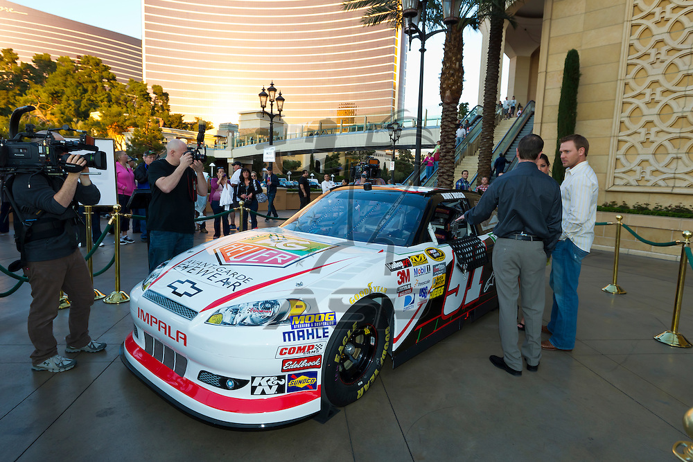 LAS VEGAS, NV - MAR 08, 2012:  Kurt Busch (51) signs autographs and meets the fans at the Optica Store appearance inside the Venetian Hotel in Las Vegas, NV.
