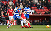 Charlton Athletic player Marco Motta (47) and Reading defender Michael Hector (8) during the Sky Bet Championship match between Charlton Athletic and Reading at The Valley, London, England on 27 February 2016.