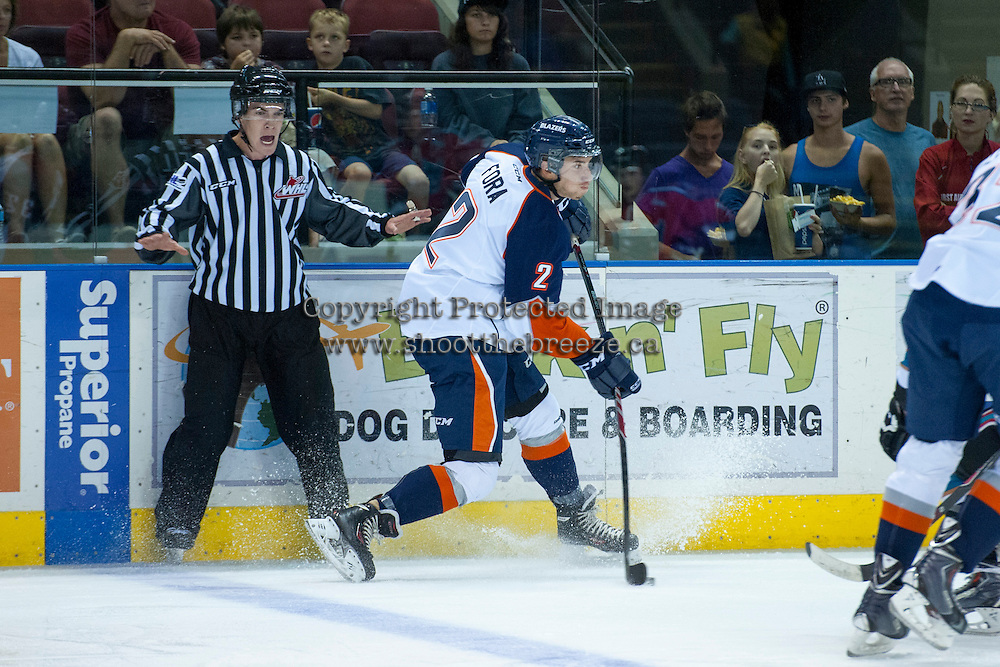 KELOWNA, CANADA - AUGUST 30: Kamloops Blazers prospect #2 Michael Fora takes a shot in front of linesman Kevin Crowell on August 30, 2014 during pre-season at Prospera Place in Kelowna, British Columbia, Canada.   (Photo by Marissa Baecker/Shoot the Breeze)  *** Local Caption *** Kevin Crowell; Michael Fora;