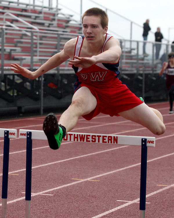 Southwestern's Jordon Powers clears the last hurdle en-route to winning the 400 hurdles 5-7-12 photo by Mark L. Anderson