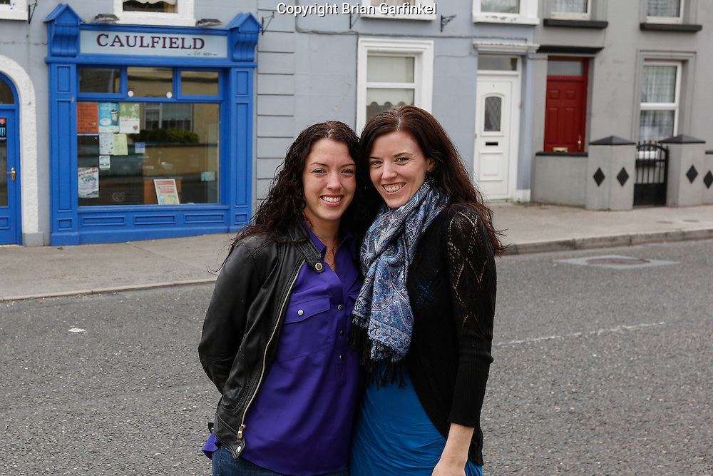 """Allison and Julie Ann in front of a store by the name of """"Caulfield"""" near Granlahan, County Roscommon, Ireland on Tuesday, June 25th 2013. (Photo by Brian Garfinkel)"""