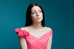 Portrait of Young Woman in Pink Dress