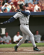 Seattle Mariner Ken Griffey Jr. hits one deep and out of the park against the Kansas City Royals at Kauffman Stadium in Kansas City, Missouri in 1995.