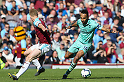 Arsenal forward Pierre-Emerick Aubameyang (14) and Burnley defender Ben Mee (6) during the Premier League match between Burnley and Arsenal at Turf Moor, Burnley, England on 12 May 2019.