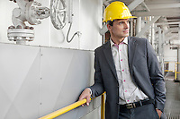 Young male architect in hand hat at industry