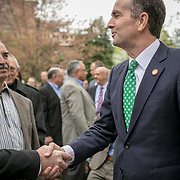 Virginia Governor Ralph Northam, right, greets former Va. Gov. George Allen, with Ken Branham, center, former Chief of Monacan Nation, during the dedication ceremony for Mantle: Virginia Indian Tribute, a monument designed on Virginia State Capitol Square, in Richmond, Virginia, on Tuesday, April 17, 2018. John Boal Photography