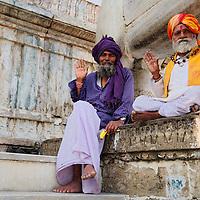 Men sitting outside the entrance of Jagdish Mandir