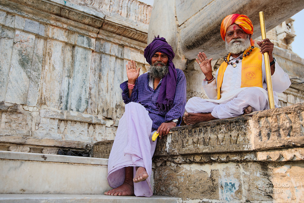 Men sitting outside the entrance of Jagdish Mandir