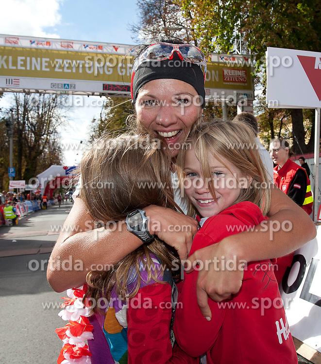 09.10.2011, Innenstadt, Graz, AUT, Graz Marathon 2011, im Bild die schnellste Österreicherin Tina Zehentner (AUT, #512) im Ziel mit ihren beiden Töchtern, EXPA Pictures © 2011, PhotoCredit: EXPA/ Erwin Scheriau