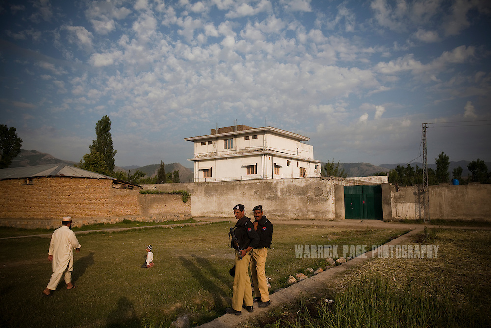 Pakistani policemen stand guard outside the compound where Osama Bin Laden was killed by US forces, on 5 May, 2011, in Abbottabad, Pakistan.  The operation, code-named Operation Neptune Spear, was launched from neighbouring Afghanistan by Seal Team Six. U.S. forces took bin Laden's body to Afghanistan for identification, then dumped it the Arabian Sea. Pakistan has since been widely suspected as having prior knowledge of his whereabouts as the compound was less than a kilometre from the country's biggest military academy. Osama bin Laden was allegedly responsible for supporting the bombing of the US Embassy in Nairobi, Kenya, the attack on the USS Cole and the suicidal attacks of September 11, 2001 in the US. (Photo by Warrick Page)