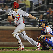 Matt Holliday, St. Louis Cardinals, driving in a run with a sacrifice fly during the St. Louis Cardinals six run sixth inning during the New York Mets Vs St. Louis Cardinals MLB regular season baseball game at Citi Field, Queens, New York. USA. 19th May 2015. Photo Tim Clayton