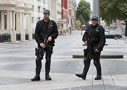 © Licensed to London News Pictures. 07/10/2017. London, UK. Armed police stand in Exhibition Road after a car had been reportedly been driven into pedestrians in an incident outside the Natural History Museum. Early reports say a man has been arrested after pedestrians injured. Photo credit: Peter Macdiarmid/LNP