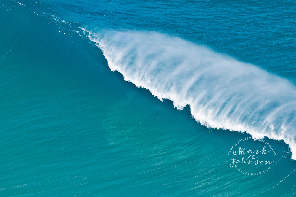 Wave breaking off the Na Pali Coast, Kauai, Hawaii