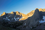 High angle view at sunrise of the Cirque of the Towers from Skunk Knob, just below Texas Pass in the Wind River Range, mountains in the Shoshone National Forest, Fremont County, Wyoming, USA. Views of the Warrior, Warbonnet Peak and Pingora Peak.