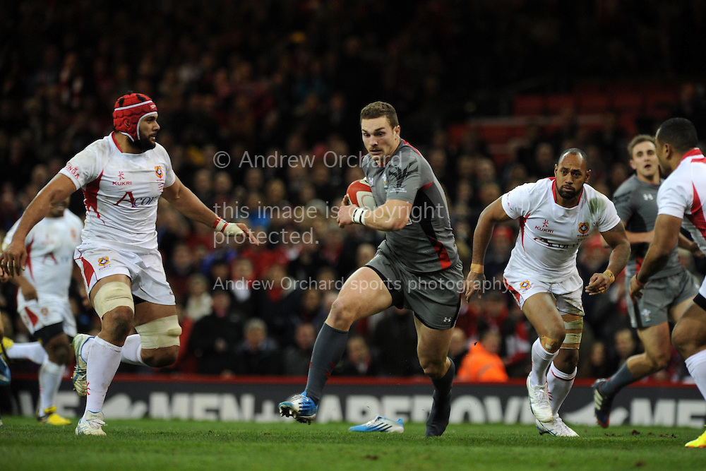 George North of Wales © makes a break. Dove Men series, autumn international rugby match, Wales v Tonga at the Millennium Stadium in Cardiff, South Wales on Friday 22nd November 2013. pic by Andrew Orchard, Andrew Orchard sports photography,