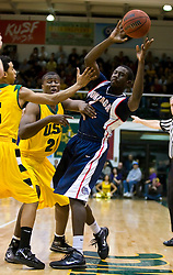 January 30, 2010; San Francisco, CA,USA;  Gonzaga Bulldogs forward Mangisto Arop (1) is guarded by San Francisco Dons center Moustapha Diarra (21) during the first half at the War Memorial Gym.   San Francisco defeated Gonzaga 81-77 in overtime.