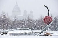 Walker Art Institute outdoor garden ?Spoon and Cherry? by Claus.Oldenburg in Minneapolis, Minnesota during a snow flurry.