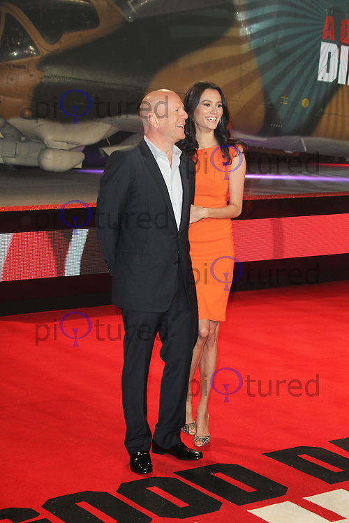 Bruce Willis; Emma Heming, A Good Day To Die Hard - UK Film Premiere, Empire Cinema Leicester Square, London UK, 07 February 2013, (Photo by Richard Goldschmidt)