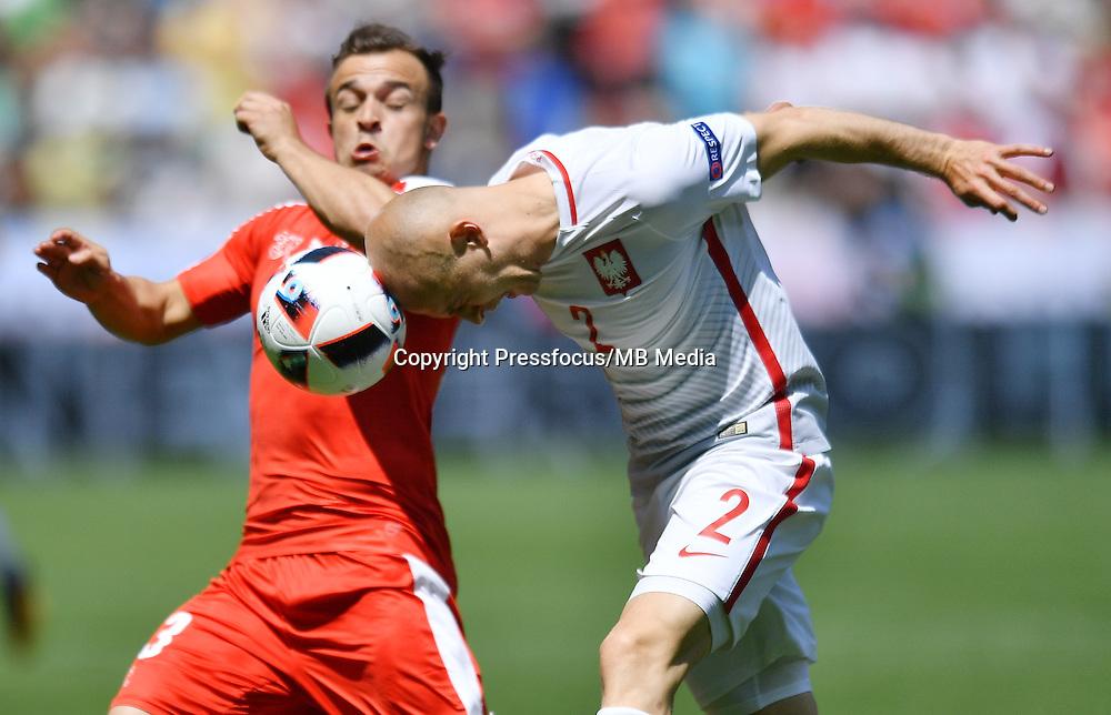 2016.06.25 Saint-Etienne<br /> Pilka nozna Euro 2016<br /> mecz 1/8 finalu Szwajcaria - Polska<br /> N/z Xherdan Shaqiri Michal Pazdan<br /> Foto Lukasz Laskowski / PressFocus<br /> <br /> 2016.06.25<br /> Football UEFA Euro 2016 <br /> Round of 16 game between Switzerland and Poland<br /> Xherdan Shaqiri Michal Pazdan<br /> Credit: Lukasz Laskowski / PressFocus