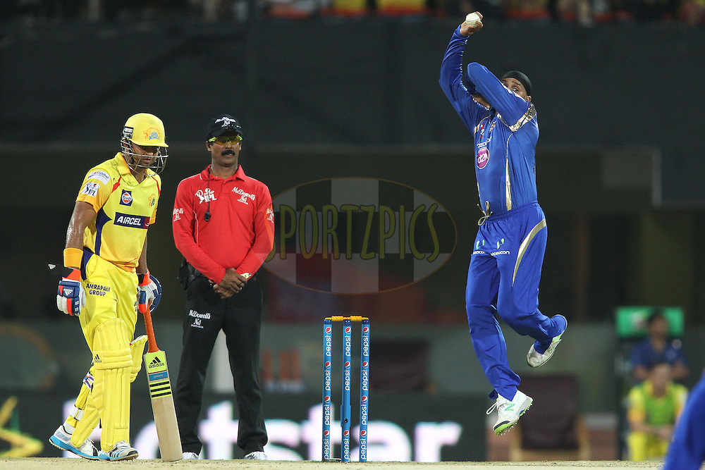 Harbhajan Singh of Mumbai Indians sends down a delivery during match 43 of the Pepsi IPL 2015 (Indian Premier League) between The Chennai Super Kings and The Mumbai Indians held at the M. A. Chidambaram Stadium, Chennai Stadium in Chennai, India on the 8th May April 2015.<br /> <br /> Photo by:  Shaun Roy / SPORTZPICS / IPL
