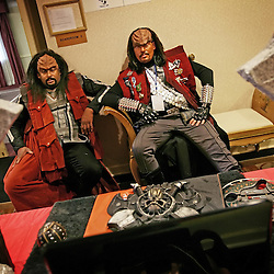 Kyle Green | The Roanoke Times<br /> March 01, 2009 - Roger Miller (right), and John Martin (left), pass time watching a home made Star Trek movie while waiting to give a lecture on Klingon dress at the Holiday Inn in Roanoke, Virginia during the 17th annual SheVaCon science fiction and fantasy convention. Miller and Martin are members of IKV Bat'leth, a Klingon based Star Trek fan club of South-Eastern Virginia.