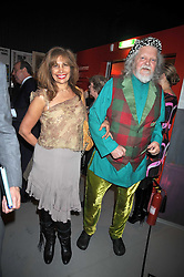 The MARQUESS OF BATH and TRUDIE JUGGERNAUTH-SHARMA at a party to celebrate the opening of Topolski Century held at The Arches, Hungerford Bridge, London SE1 on 16th March 2009.