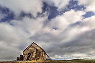 Old dilapidated school house nearly falling down, Palouse region of eastern Washington.
