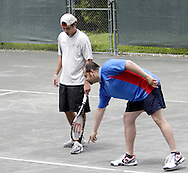 Service Line Umpire Stefan Czerwinski, from Oakwood shows Ross Wilson, from Toledo the mark on the court from a ball in the first set of the finals in the 41st Weston Memorial Tennis Tournament at the Virginia Hollinger Memorial Tennis Club, Monday, May 26, 2008.