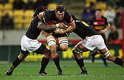 Canterbury captain George Whitelock tries to break the tackles of Ma'a Nonu and Victor Vito.<br /> Air NZ Cup Ranfurly Shield match - Wellington Lions v Canterbury at Westpac Stadium, Wellington, New Zealand. Saturday, 29 August 2009. Photo: Dave Lintott/PHOTOSPORT