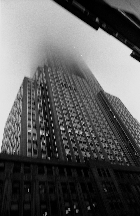 "Empire State Building during rainstorm and fog...Part of long-term (2005-2008) story ""I See A Darkness"". New York, NY."