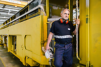 GIOIA TAURO, ITALY - 13 JUNE 2018: Head Mechanic Renato Tocci poses for a portrait by a locomotive here at Gruppo Ventura,  a family-owned company that installs railroad tracks and does locomotives maintenance,  in Gioia Tauro, Italy, on June 13th 2018.<br /> <br /> Alessandro Ventura, CFO of Gruppo Ventura, traveled there some 20 times over the last three years, establishing a venture with an Iranian company engaged in expanding the national rail network. In March 2017, he signed a 2 million euro contract (about $2.3 million) to service a section of rail outside Teheran.<br /> He shipped two locomotives used to tamp down the rocks below railroad tracks. They went out on a freighter from Gioia Tauro, a port on the Tyrrhenian Sea that has long been notorious as a Mafia-run conduit for cocaine trafficking.<br /> Last August, Mr. Ventura stood at the Iranian port of Bandar Abbas in 122 degree heat, watching a crane hoist the locomotives onto the docks.<br /> Now, those machines are effectively marooned, the business halted. Gruppo Ventura has lost appetite for adventurous expansion.<br /> <br /> Once the Obama administration struck the nuclear deal with Iran three years ago, Italy saw a chance. Last year, Italy exported more than 1.7 billion euros (nearly $2 billion) worth of goods to Iran. Then, President Trump withdrew the United States from the Iran deal and vowed to reinstate sanctions, dealing a blow to companies across Europe — especially those from Italy, Germany and France.