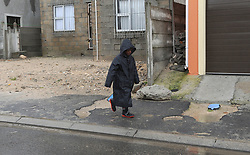 "South Africa - Cape Town - 10 June 2020 - Boy walkling home in the rain as a intense cold front hits Cape Town causing extremely cold temperatures, strong winds and rain. Picture"" Brendan Magaar/African News Agency(ANA)"