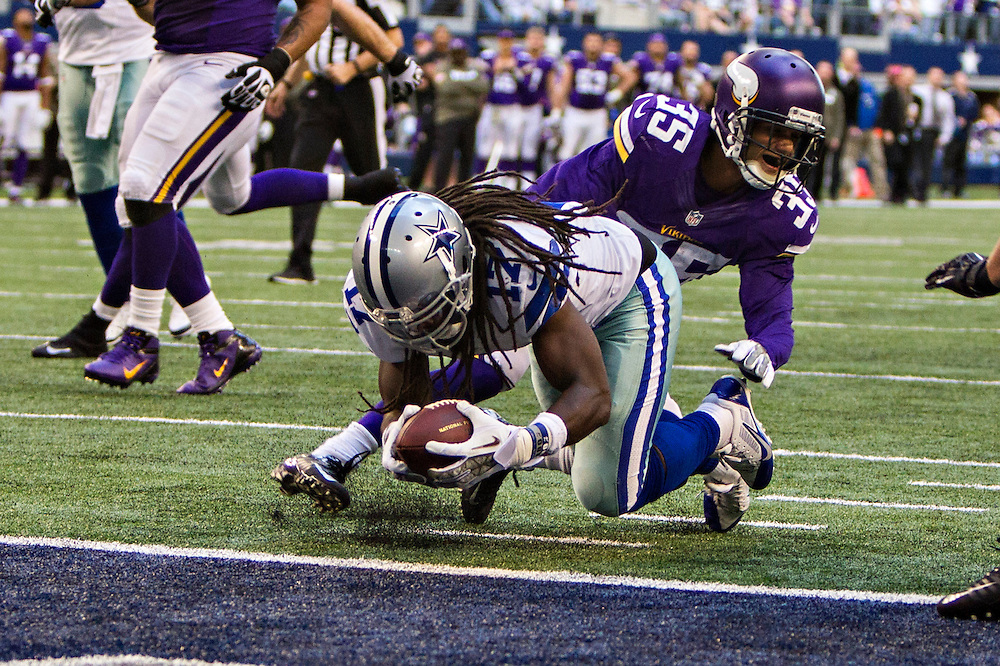 ARLINGTON, TX - NOVEMBER 3:  Dwayne Harris #17 of the Dallas Cowboys scores a touchdown against the Minnesota Vikings at AT&T Stadium on November 3, 2013 in Arlington, Texas.  The Cowboys defeated the Vikings 27-23.  (Photo by Wesley Hitt/Getty Images) *** Local Caption *** Dwayne Harris